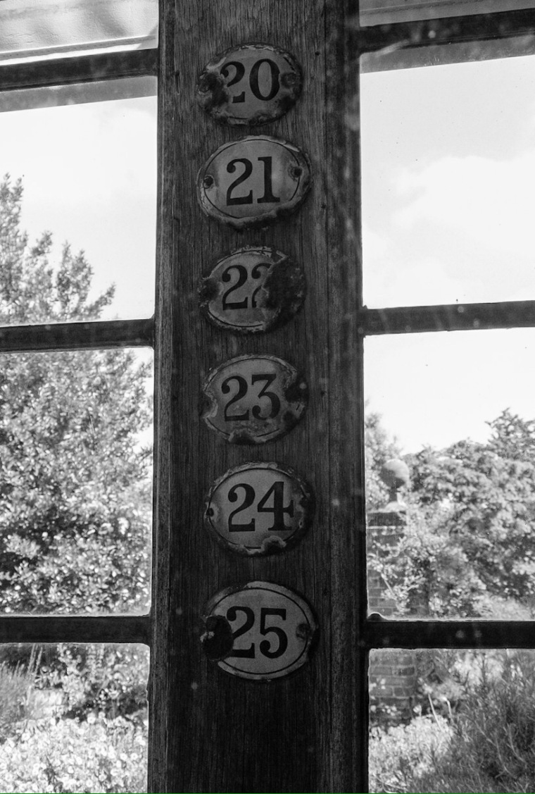 Little Hall, Lavenham. Abstract digital photograph of old door numbers.