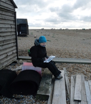 Sketching in the lee of a fishing hut, Dungeness. © Mari French 2018