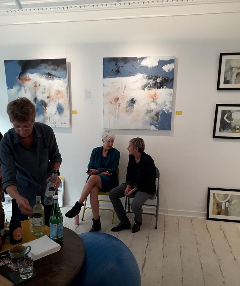Artist Ruth McCabe chats with Gallery owner Susie Turner in front of my wall of work.